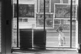 Little boy walking past the office of the Student Nonviolent Coordinating Committee in downtown...
