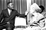 Solomon Seay, Jr., speaking to an elderly white woman at a conference in Montgomery, Alabama,...