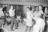 Lula Williams singing on a sidewalk in downtown Montgomery, Alabama, during a civil rights...