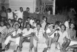 Group standing and sitting on a sidewalk in a neighborhood in Montgomery, Alabama, during a civil...