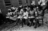 Audience seated in chairs outside a brick church building in Prattville, Alabama, during a civil...
