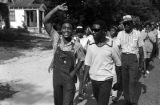 Edward Rudolph leading marchers down a street in Prattville, Alabama, during a demonstration...