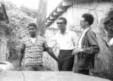 Stokely Carmichael, Rap Brown, and another young man standing beside a car after Carmichael's...