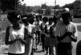 Group marching down a road in Prattville, Alabama, during a demonstration sponsored by the Autauga...