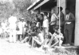 Large group standing on the porch of the Autauga County Improvement Association office in...