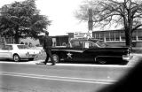 Car displaying campaign signs, parked in front of the Autauga County Training School during a...