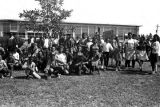 Students seated and standing in front of the Autauga County Training School in Autaugaville,...