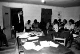 Man addressing an audience at the office of the Autauga County Improvement Association in...