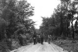 Edward Rudolph leading marchers down an unpaved road in Prattville, Alabama, during a...
