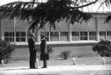 Two men talking outside the Autauga County Training School in Autaugaville, Alabama, during a...