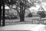 Students running around the Autauga County Training School in Autaugaville, Alabama, during a...