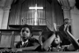 Little girl in the audience at Brown Chapel in Selma, Alabama, during a civil rights meeting.