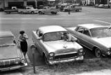 Cars parked outside a building, probably where a class was held at the Manpower Development and...