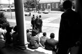 Students and faculty from Tuskegee Institute seated on the front steps of Tuskegee Methodist...
