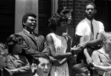 Wendell Paris and other students and faculty from Tuskegee Institute, standing on the front steps...