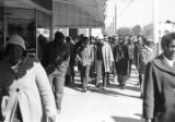 Simuel Schutz, Jr., Wendell Paris, and other students from Tuskegee Institute marching down a...