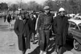 Wendell Paris and other students from Tuskegee Institute marching down a sidewalk on Old...