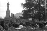 Dr. Frank Toland addressing a crowd seated in front of the Confederate monument in Tuskegee,...