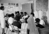 Women seated at a table during an adult education class at the Ash Creek Center in Hayneville,...