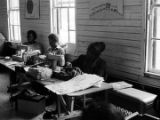 Women working at sewing machines during an adult education class at the Ash Creek Center in...
