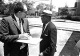Journalist speaking with Kenneth B. Young, either before or after students and faculty from...