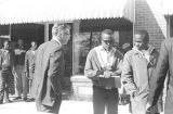 Two young men speaking to a white man in downtown Tuskegee, Alabama, during a student...