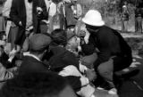 Wendell Paris speaking to people seated on a road in Tuskegee, Alabama, during a student...