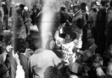 Students from Tuskegee Institute seated during a demonstration to protest the murder of Samuel L....
