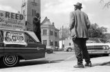 Thomas Reed addressing people on a sidewalk in downtown Tuskegee, Alabama, during his campaign for...