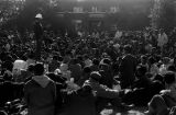 Wendell Paris addressing students gathered outside Logan Hall at Tuskegee Institute, during a...