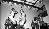 Three young women dancing on stage during a performance of Bobby Moore and the Rhythm Aces at a...