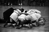 Members of the basketball team for I. C. Norcom High School in Portsmouth, Virginia, huddled on...