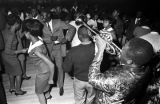 Member of The Sheiks playing the trumpet on the floor in front of the stage at the Laicos Club in...