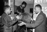 Men loading a trailer after a performance of Bobby Moore and the Rhythm Aces at a dance at the...