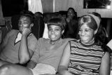 Marion Sledge and two young women on the bus for Bobby Moore and the Rhythm Aces, after a...