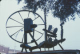 Spinning wheel on top of a car during a First Monday trade day in Scottsboro, Alabama.