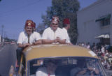 Members of the Alcazar Shriners riding in the back of a vehicle during the Peanut Festival parade...