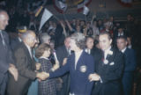 George and Lurleen Wallace walking through a crowd at a rally in the Municipal Auditorium in...