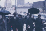 Edward Gardner and other demonstrators marching to the Jefferson County courthouse in Birmingham,...