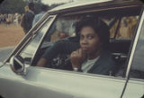 Woman seated in a car during the homecoming parade for Booker T. Washington High School in...