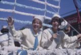 Girls in sailor outfits riding on a float during the Peanut Festival parade in downtown Dothan,...