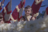 Little girl wearing an American Indian costume and riding on a float during the Peanut Festival...