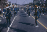 Marching band performing during the homecoming parade for Booker T. Washington High School in...