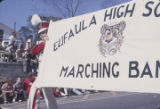 Member of the Eufaula High School marching band carrying a banner during the Peanut Festival...