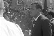 Coretta Scott King on the arm of Alfred D. King during the funeral procession for Martin Luther...