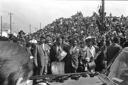 Car passing by onlookers at Martin Luther King, Jr.'s funeral.