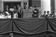 Speakers on a platform during a funeral service for Martin Luther King, Jr., at Morehouse College.