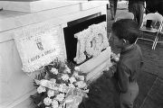 "Young boy looking at the ""I Have a Dream"" memorial at Martin Luther King, Jr.'s grave..."