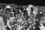 Mourners behind funeral wreaths at Martin Luther King, Jr.'s grave site.