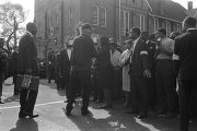 Deliveryman carrying cross-shaped floral arrangement to Ebenezer Baptist Church for Martin Luther...